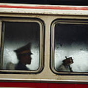A Chinese Pla Soldier Sits On A Bus Art Print