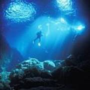 A Diver Hovers Inside The Archway As Art Print