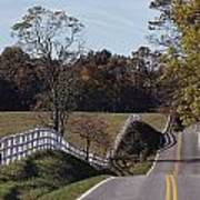 A Hilly Country Road Passes A Fenced Art Print