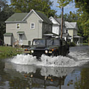 A Humvee Drives Through The Floodwaters Art Print