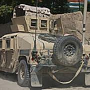 A Humvee Patrols The Streets Of Kunduz Art Print