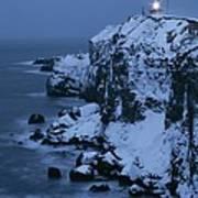 A Lighthouse Atop Snow-covered Cliffs Art Print