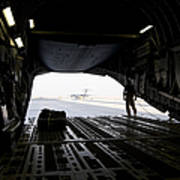 A Loadmaster Guides The Pilot Of A C-17 Art Print