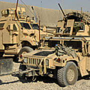 A M1114 Humvee Sits Parked In Front Art Print