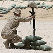 A Marine Hangs Dog Tags On The Rifle Art Print