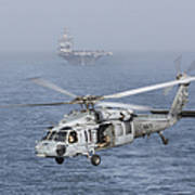 A Mh-60s Knighthawk Conducts A Vertical Print by Gert Kromhout