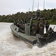 A Navy Riverine Patrol Boat Conducts Art Print