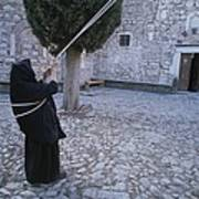 A Nun Pulls On Ropes In A Courtyard Print by Tino Soriano