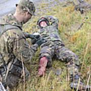 A Patrol Medic Applies First Aid Art Print