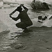 A Photographer Processes Film Among Ice Art Print