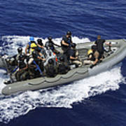 A Rigid-hull Inflatable Boat Carrying Art Print by Stocktrek Images
