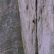 A Rock Climber Clings To An Overhang Art Print