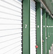 A Row Of Locked Storage Units At A Self Storage Facility Art Print by Frederick Bass
