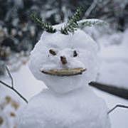 A Smiling Snowman With Twig Arms Art Print
