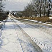 A Snow-covered Road Passes Art Print by Joel Sartore