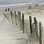 A Snow Fence Stretches Across A Dune Art Print by Skip Brown