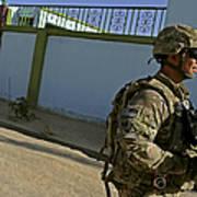 A Soldier Patrols The Streets Of Qalat Art Print