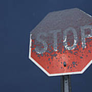 A Stop Sign Covered In Snow Print by John Burcham