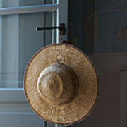 A Sun Hat Hangs On The Door Of A Tuscan Art Print