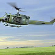 A Uh-1n Huey Helicopter Prepares Art Print