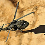 A Uh-60 Black Hawk Helicopter Comes Art Print