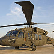 A Uh-60 Black Hawk Parked At A Military Art Print