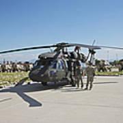A Uh-60l Blackhawk Parked On Its Pad Art Print