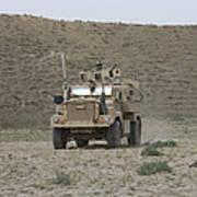 A U.s. Army Cougar Patrols A Wadi Art Print