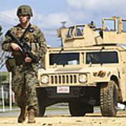 A U.s. Marine Guides A Humvee Art Print