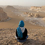A Woman Sits Quietly On A Cliff Looking Art Print
