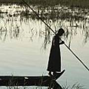 A Woman Stands At The End Of A Rowboat Print by Lynn Abercrombie