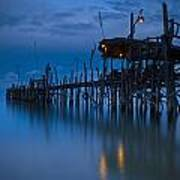 A Wooden Pier With Lights On It At Art Print