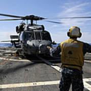 Airman Signals To An Mh-60s Sea Hawk Art Print