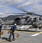 Airmen Prepare To Chock And Chain An Art Print