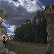 Airmen Use A Range Finder And Gps Unit Art Print