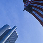 American Flag And Renaissance Center In Detroit, Michigan Art Print by Will & Deni McIntyre