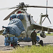 An Afghan Army Soldier Guards A Mi-35 Art Print