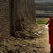An Afghan Girl Carries Her Little Art Print