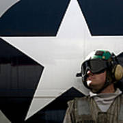 An Airman Stands In Front Of A C-2a Art Print