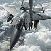 An F-15 E Strike Eagle Receives Fuel Art Print by Stocktrek Images