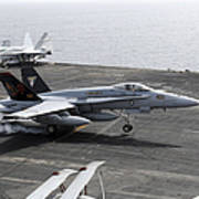 An Fa-18a+ Hornet Lands Aboard Art Print