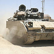 An M2 Bradley Fighting Vehicle Patrols Art Print