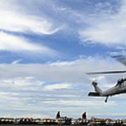 An Mh-60s Sea Hawk Lifts A Pallet Art Print