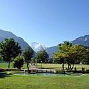 An Open Field In Interlaken With A View Of The Mountains In The Background Art Print