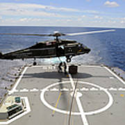 An Sh-60f Sea Hawk Helicopter Lowers Art Print