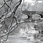 Arch Bridge Over Frozen River In Winter Art Print