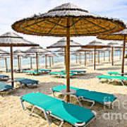 Beach Umbrellas On Sandy Seashore Art Print by Elena Elisseeva
