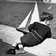 Boy Playing With Toy Sailboat Art Print