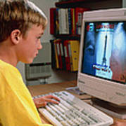Boy Using A Multimedia Computer To Learn French Art Print by Damien Lovegrove