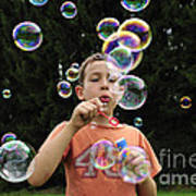 Boy With Colorful Bubbles Art Print by Matthias Hauser